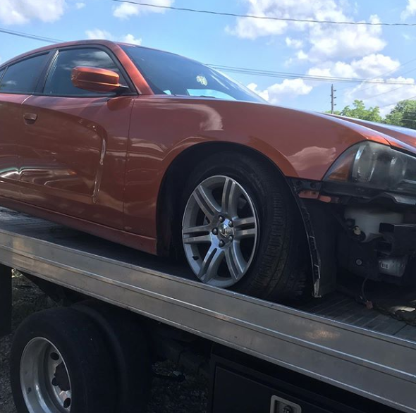 orange car on a tow truck